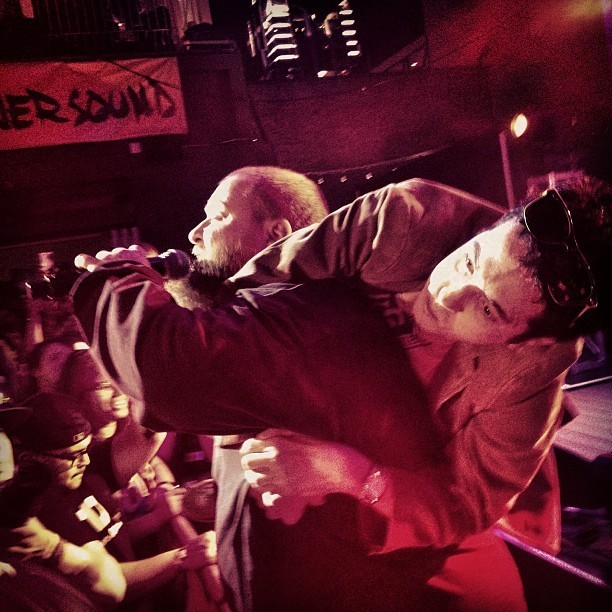 Action Bronson on stage and under a fan, at SXSW in Austin, Texas.