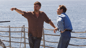 Paul Thomas Anderson (left) works with actor Joaquin Phoenix on the set of The Master.