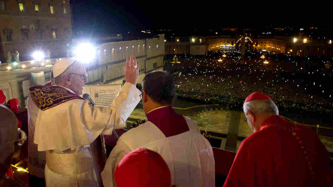 The newly elected Pope Francis  appears on the main balcony of St Peter's Basilica. His name was chosen after St. Francis of Assisi, the Vatican says.