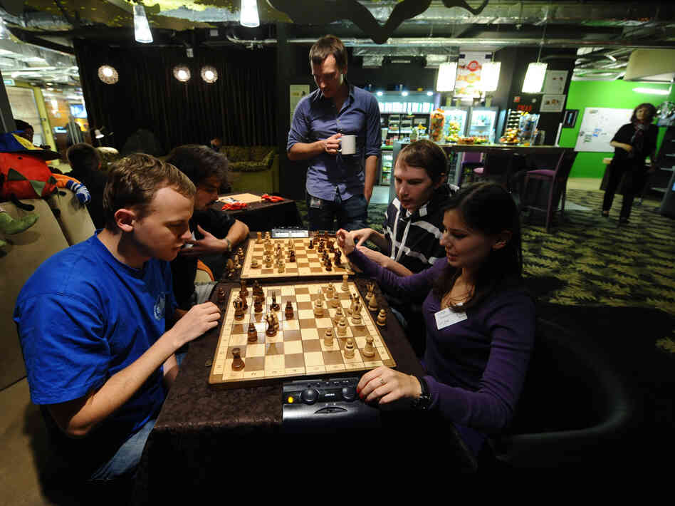 "Google employees play chess at the company's Russian headquarters in Moscow. Experts say tech companies are using ""serendipitous interaction"" in their workplace design to promote idea sharing and communication between employees."
