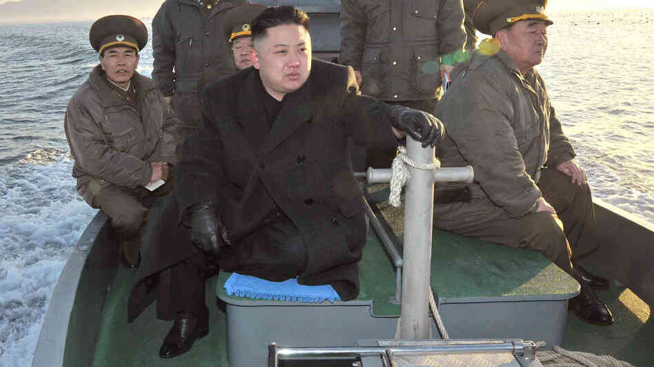 North Korean leader Kim Jong Un rides on a boat near the sea border with South Korea in this March 11 photo released by the Korean Central News Agency. Bellicose rhetoric from North Korea has put other countries in the region on edge.