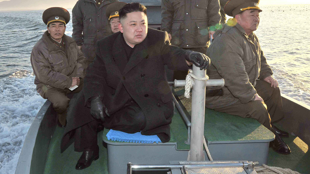 North Korean leader Kim Jong Un rides on a boat near the sea border with South Korea in this March 11 photo released by the Korean Central News Agency. Bellicose rhetoric from North Korea has put other countries in the region on edge. (AP)