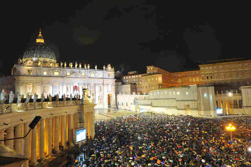 White smoke rises from the chimney on the roof of the Sistine Chapel, signifying that cardinals elected a new pope.