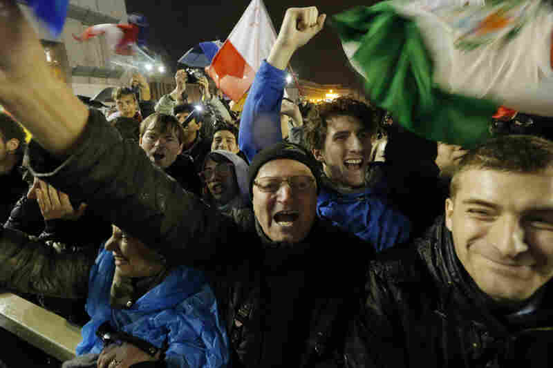 People from around the world cheer after the announcement that the next pope was selected.