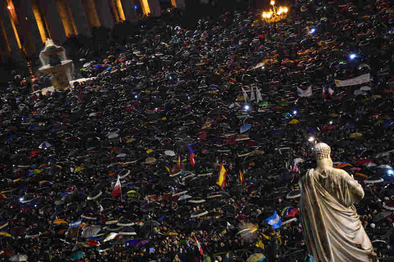 Crowds gather throughout the day to await the announcement of a new pope.