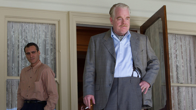 "Navy veteran Freddie (Phoenix) falls under the influence of cult leader Lancaster Dodd (Philip Seymour Hoffman) in Anderson's film, which critic Ella Taylor describes as ""one of the most twisted father-son tales ever told."" (The Weinstein Co.)"