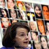 """Pictures of Newtown's Sandy Hook Elementary School shooting victims are displayed as Senate Judiciary Committee chairperson Dianne Feinstein speaks during a hearing on """"The Assault Weapons Ban of 2013"""" at the Hart Senate Office Building in Washington, DC, on February 27, 2013."""