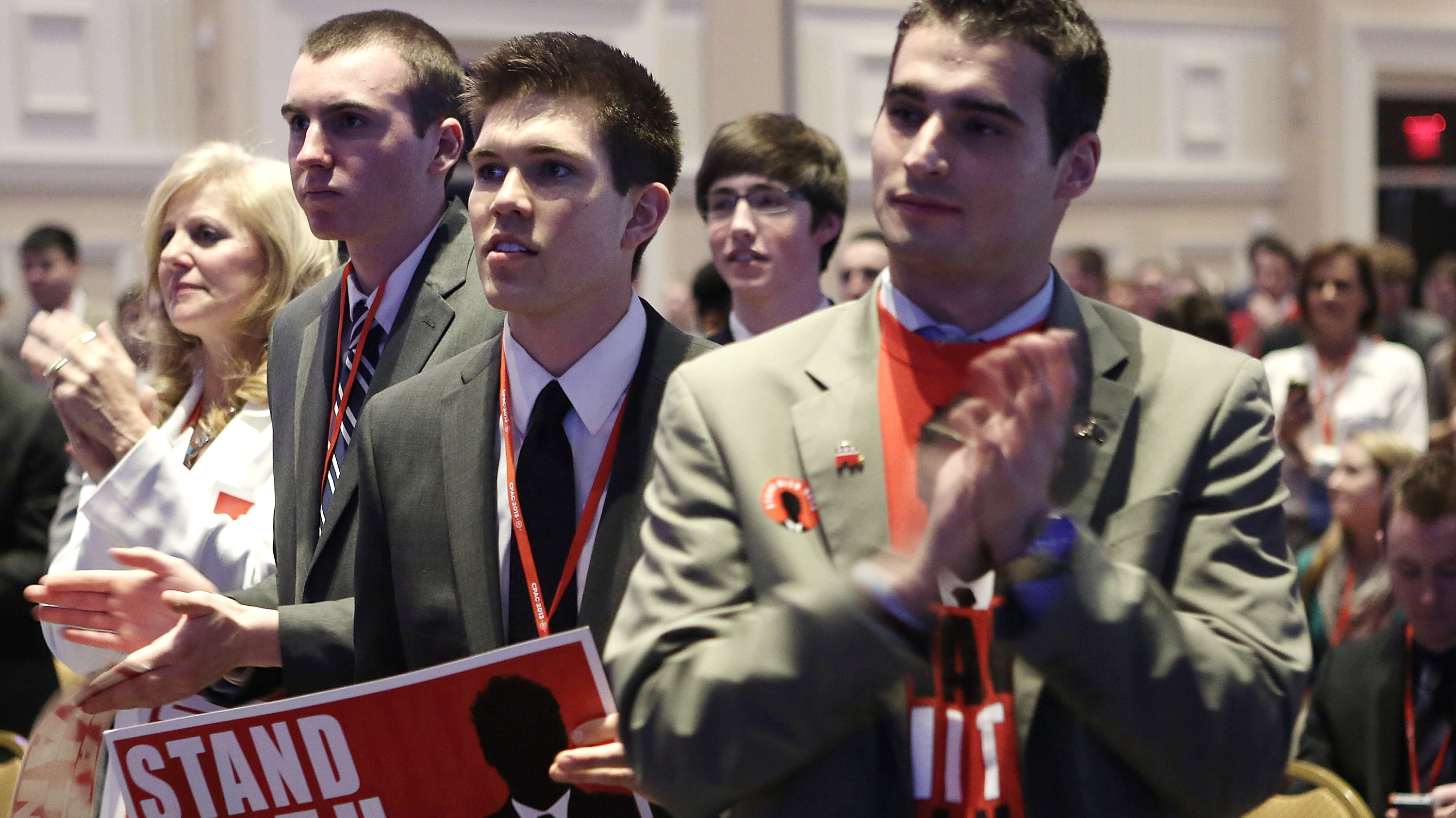 Supporters of Sen. Rand Paul, R-Ky., stand and applaud as Paul addresses the CPAC gathering.