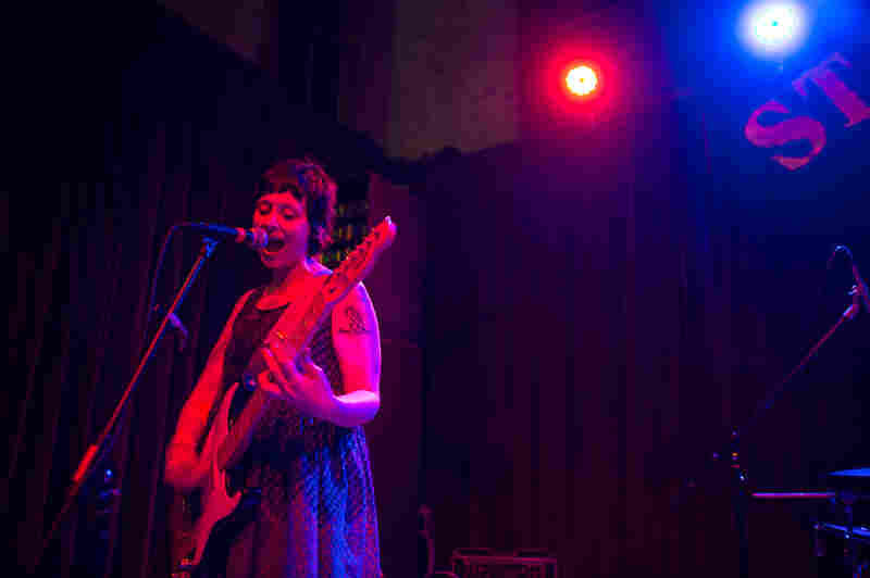 Waxahatchee's Katie Crutchfield began her set at the indoor stage at Stubb's by strumming three songs alone on an electric guitar, before being joined by two band mates.