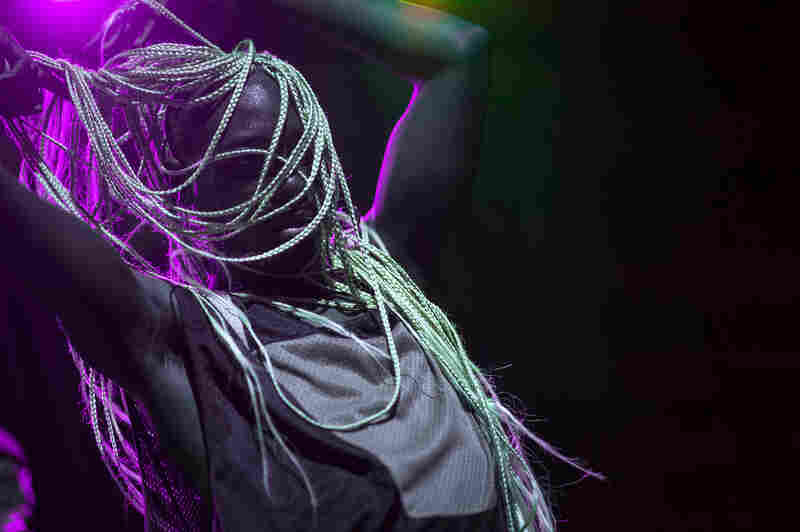 At the start of his set, Rapper Le1f's blond braids were in a bun, but they soon swung free.