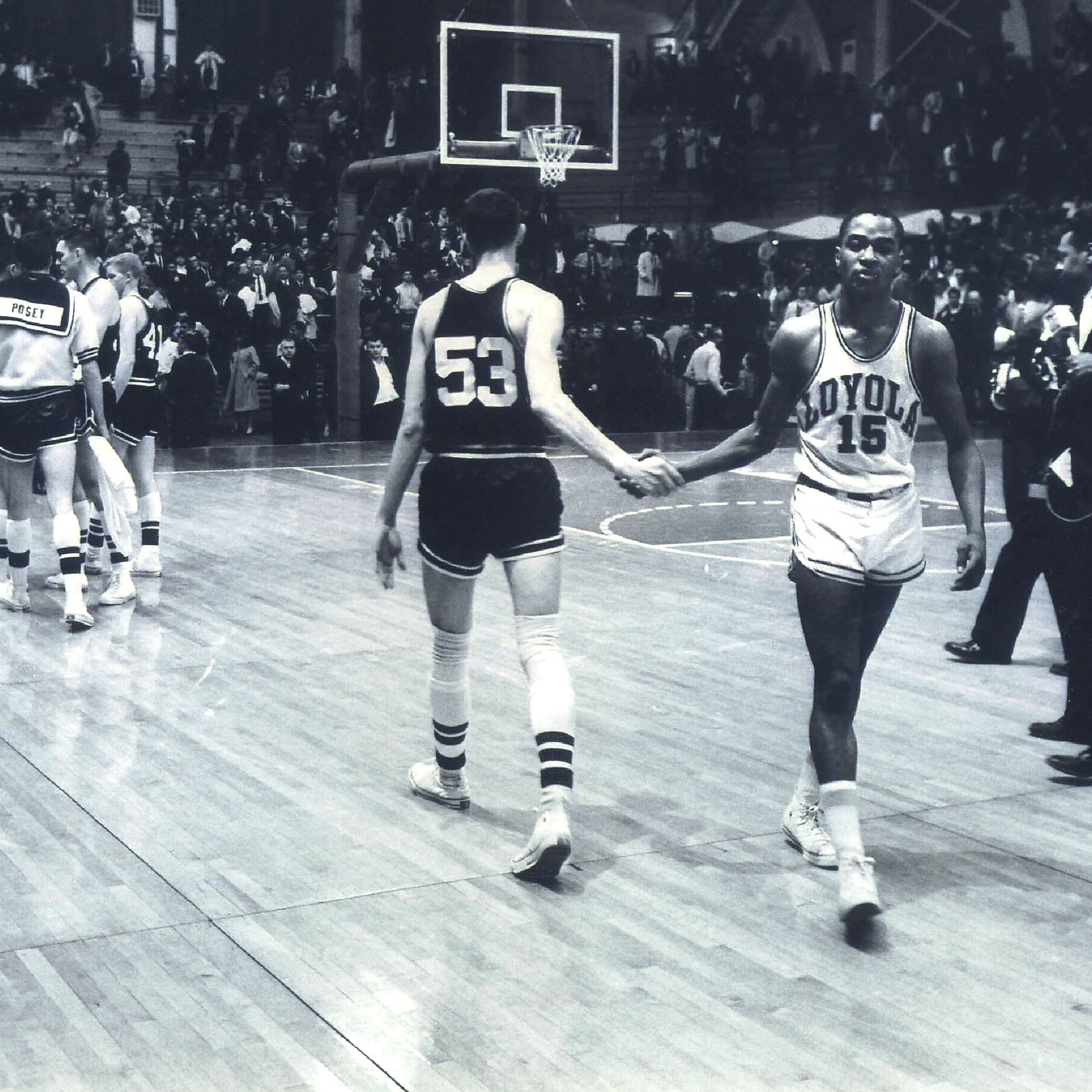 Mississippi State's Stan Brinker (left) and Loyola University's Jerry Harkness shake hands before the NCAA Mideast regional semifinal college basketball game in East Lansing, Mich.