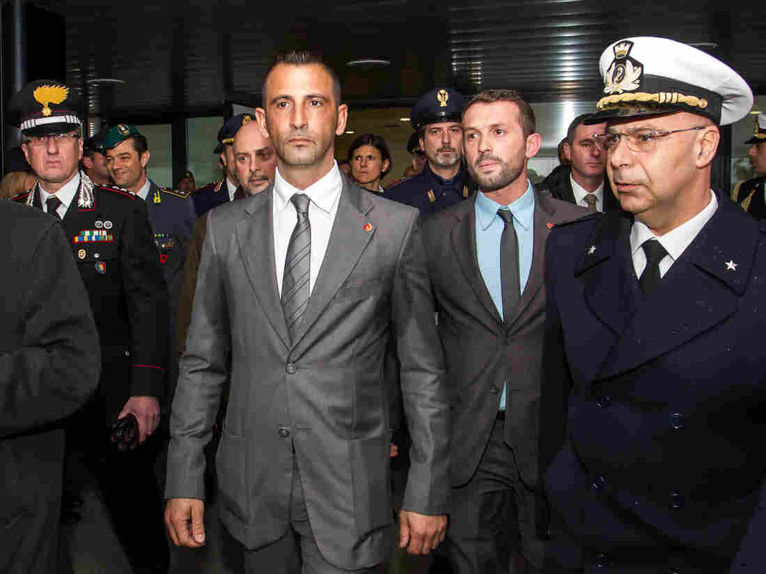 Italian marines Massimilian Latorre (left) and Salvatore Girone, who are at the center of a diplomatic row between India and Italy, return to Rome on Feb. 23. The two men have been charged in India with killing two fishermen, whom they mistook for pirates. India is demanding their return.
