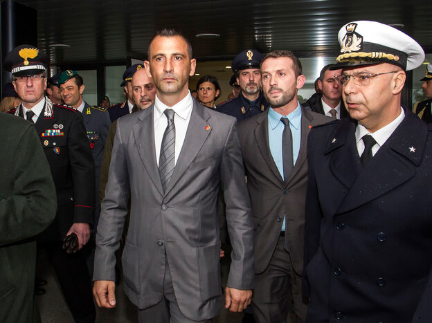 Italian marines Massimilian Latorre (left) and Salvatore Girone, who are at the center of a diplomati