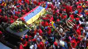 March 6: In Caracas, many Venezuelans crowded the streets to see the coffin of President Hugo Chavez.
