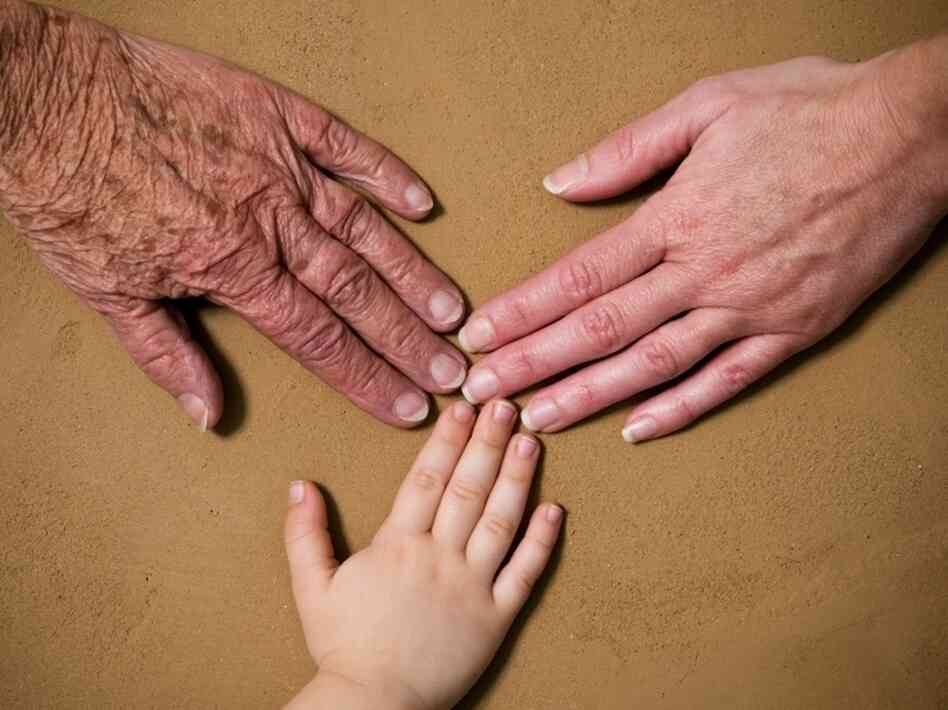 Hands from three generations.