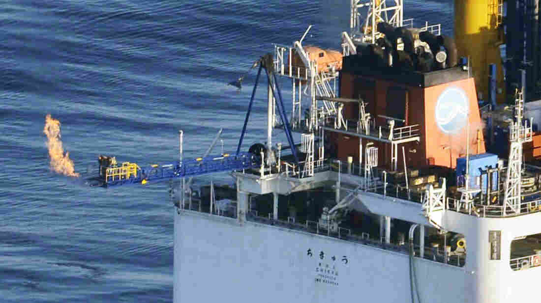 This photo from a Kyodo News helicopter shows a flame of natural gas from a Japanese deep-sea drilling ship on Tuesday. This successful extraction of methane from the seafloor was a world first.