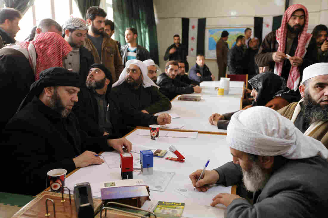 "An Islamist rebel group in Aleppo called ""the Authority for the Promotion of Virtue and Supporting the Oppressed"" reviews applications for aid on Feb. 25. In addition to handing out aid, the Islamist group says it is carrying out civilian administration in parts of Aleppo."