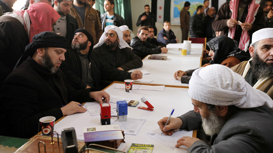 "An Islamist rebel group in Aleppo called ""the Authority for the Promotion of Virtue and Supporting the Oppressed"" reviews applications for aid on Feb. 25. In addition to handing out aid, the Islamist group says it is carrying out civilian administration in parts of Aleppo. (Reuters/Landov)"