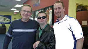 Tim with his father, Keith, and brother Dan (right) at Tim's Place. Dan is the restaurant's operations manager.