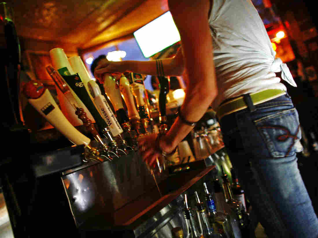 A bartender pours a beer at the Nomad Pub in Milwaukee, Wisc., in 2006.