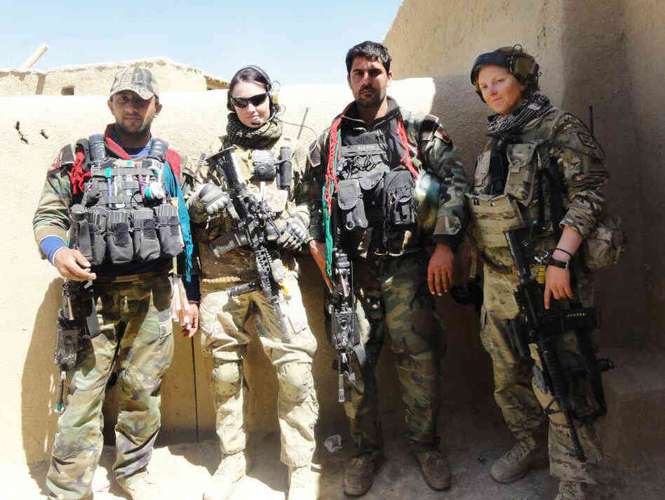 Sgt. Jaclyn O'Shea (second from left) and Sgt. Alyssa Corcoran (right) stand with Afghan commandos in Logar province, Afghanistan.