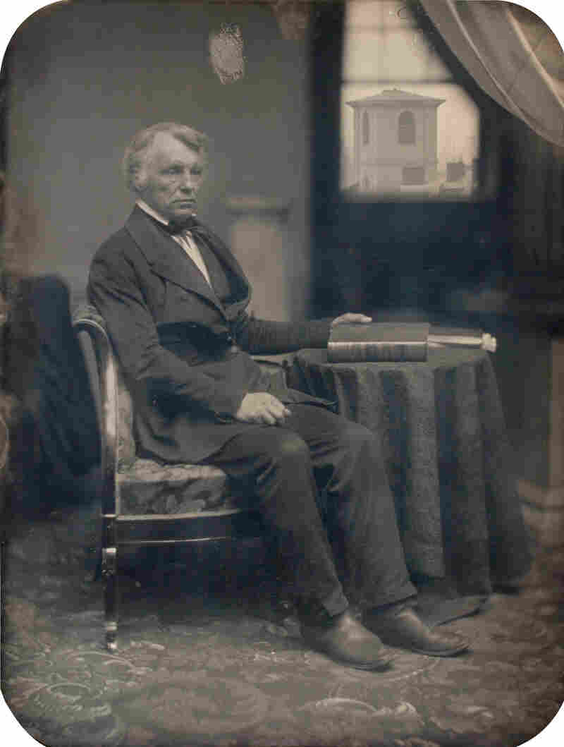 Seated man with Brattle Street Church seen through window, 1850s (Albert Sands Southworth, Josiah Johnson Hawes)