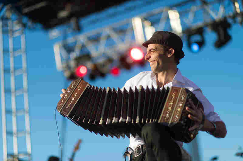 Bajofondo's Martín Ferrés stretches out his bandoneón as far as he can at Alt.Latino's SXSW showcase.