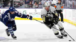 The NHL's new realignment, due to take effect next season, includes scheduling rules that should let more fans see league scoring leader Sidney Crosby, of the Pittsburgh Penguins, in person.