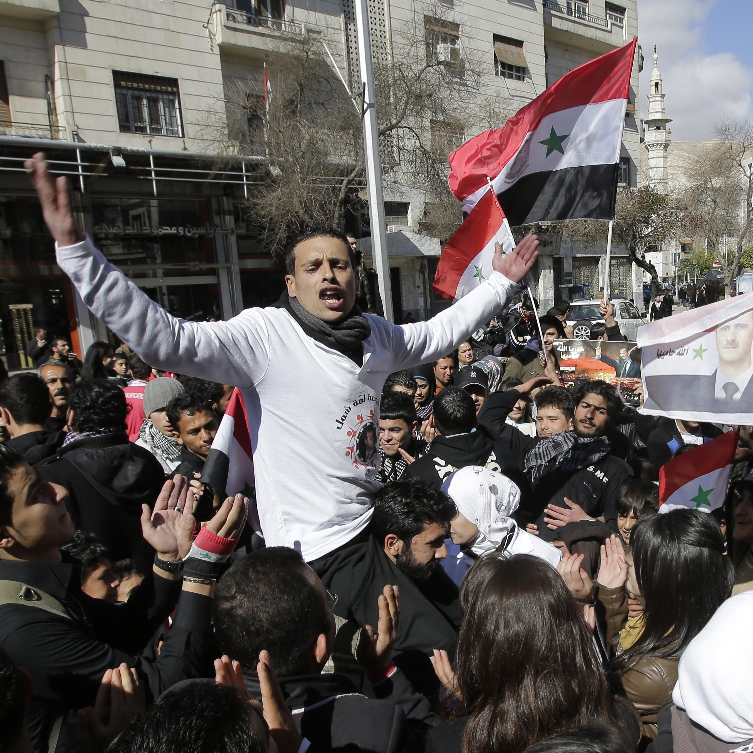 Supporters of Syrian President Bashar Assad stage a rally in central Damascus on Feb. 12.