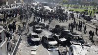 The scene of a car bomb explosion near the headquarters of Syria's ruling Baath party, in the center of Damascus, on Feb. 21. While the city is not involved in the fighting on a daily basis, the war is edging closer to the capital.