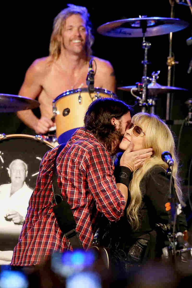 """Dave Grohl gives Stevie Nicks a big smooch at the Sound City showcase at Stubb's BBQ. During the epic-length set, Nicks performed """"Landslide"""" and """"Gold Dust Woman"""" with the band."""