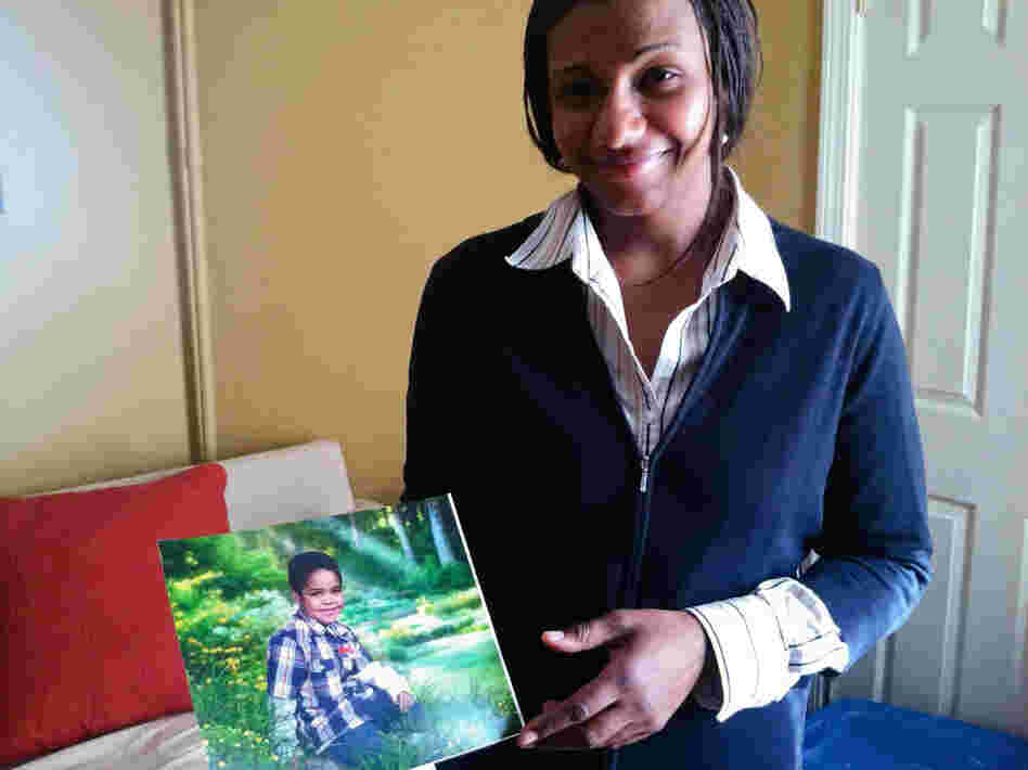 Maria Texeira-Gomes holds a photo of her 5-year-old son, Matheo, who has struggled with asthma nearly all his life.