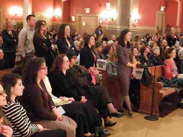 Audience members line up for the Q&A portion of the event.