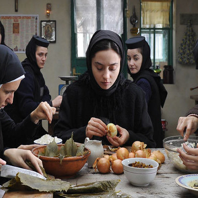 A group of nuns shares a meal in Beyond the Hills. Though the director is hesitant to underline metaphors in his film, contemporary observers won't find it hard to discover what seems like suggestive references to the Romania of dictator Nicolai Ceaucescu.