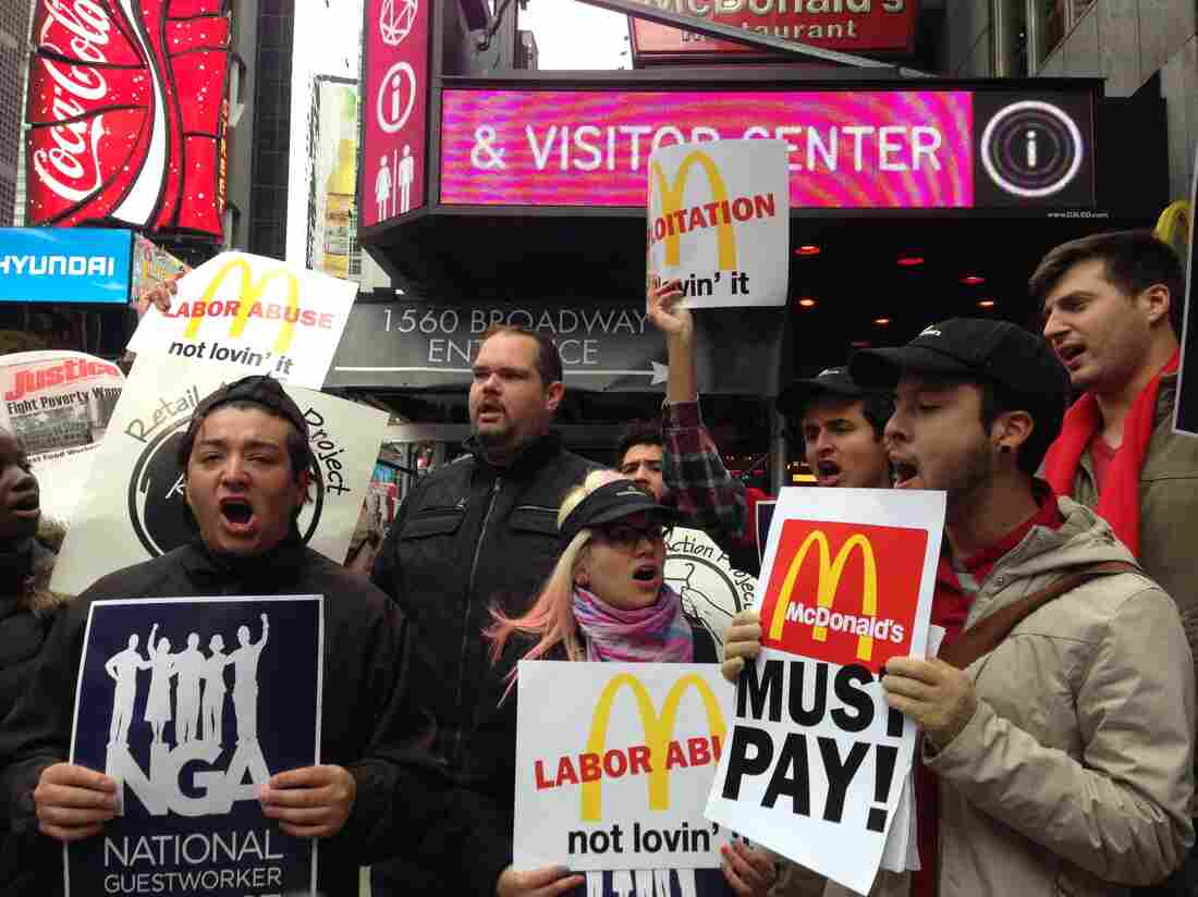 Workers and labor organizers in New York City protest the alleged exploitation of students on J-1 summer work travel visas who worked at a Pennsylvania McDonald's, on Thursday.