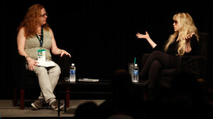 """Stevie Nicks (right), speaking in front of a crowd at SXSW in Austin, Texas, told Ann Powers that """"a big attitude"""" was her secret to being taken seriously when she joined Fleetwood Mac."""