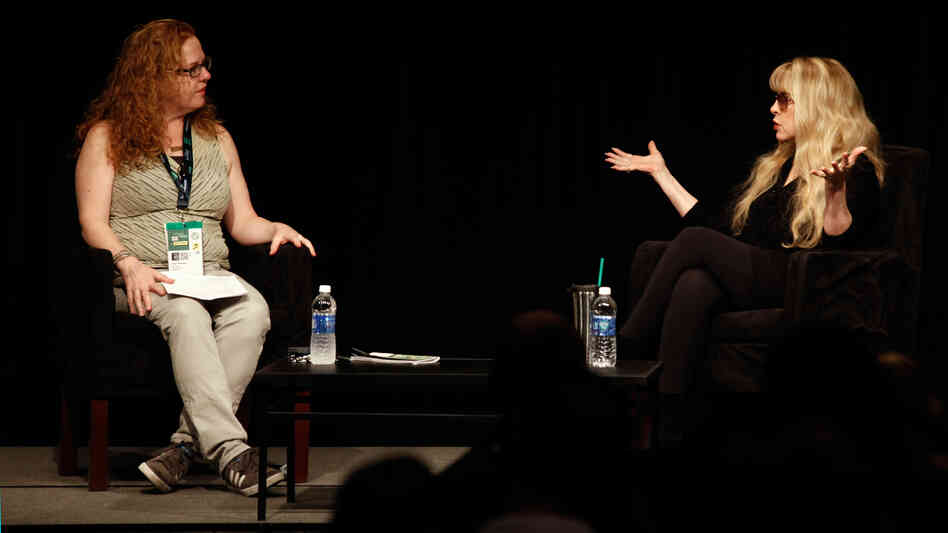 "Stevie Nicks (right), speaking in front of a crowd at SXSW in Austin, Texas, told Ann Powers that ""a big attitude"" was her secret to being taken seriously when she joined Fleetwood Mac."