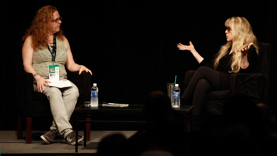 "Stevie Nicks (right), speaking in front of a crowd at SXSW in Austin, Texas, told Ann Powers that ""a big attitude"" was her secret to being taken seriously when she joined Fleetwood Mac. (NPR)"