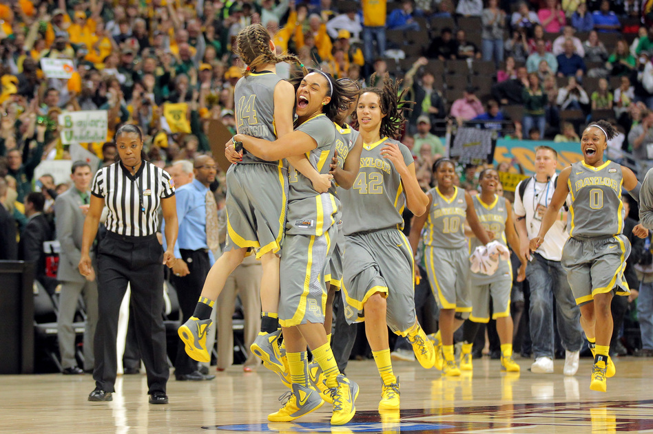 Makenzie Robertson #14, Mariah Chandler #44, Brittney Griner #42 and Odyssey Sims #0 of the Baylor Bears celebrate after they won 80-61 against the Notre Dame Fighting Irish during the National Final game of the 2012 NCAA Division I Women's Basketball Championship at in Denver.