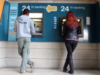 Take the money and run: An ATM in the Cypriot capital Nicosia on Sunday.