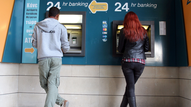 Take the money and run: An ATM in the Cypriot capital Nicosia on Sunday. (AFP/Getty Images)