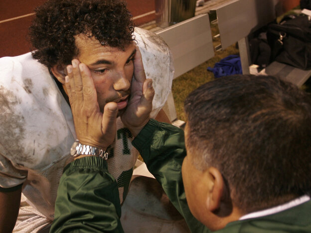 Robert Monges, a coach for James Lick High School, checks tight end Dominic Brewster for a concussion during a football game played in Morgan Hill, Calif., in 2006.