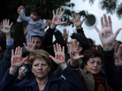 Cypriots protest an EU bailout deal outside the parliament in Nicosia on Monday. A proposed bailout deal would slap a levy on all Cypriot bank savings.