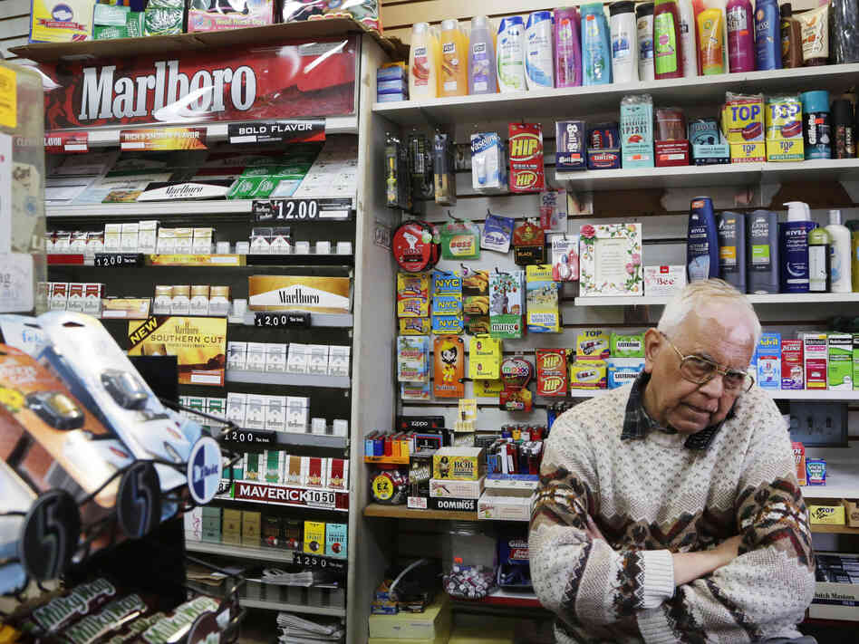 Harry Patel, an employee of Blondie's Deli and Grocery, talks on the phone while waiting for customers in New York on Monday. A new anti-smoking proposal would make New York the first city in the