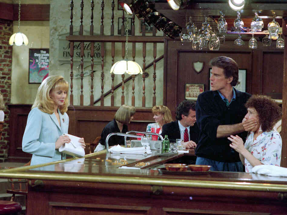 Ted Danson, playing the role of bartender Sam Malone, keeps Rhea Perlman, playing waitress Carla Tortelli, under control as Shelley Long, portraying Diane Chambers, left, returns to the set of Cheers during taping of the final episode in 1993.
