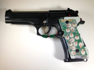 This 9 mm semi-automatic handgun is configured with transducers in its handle that can detect the grasp of an authorized user.