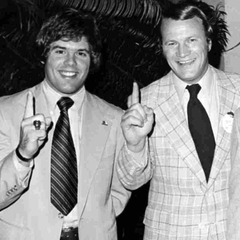 """Oklahoma quarterback Steve Davis, left, and coach Barry Switzer celebrate the team's No. 1 ranking after the Orange Bowl in 1976. Davis, 60, died Sunday in the crash of a small plane. Switzer called Davis a """"great role model for young people."""""""