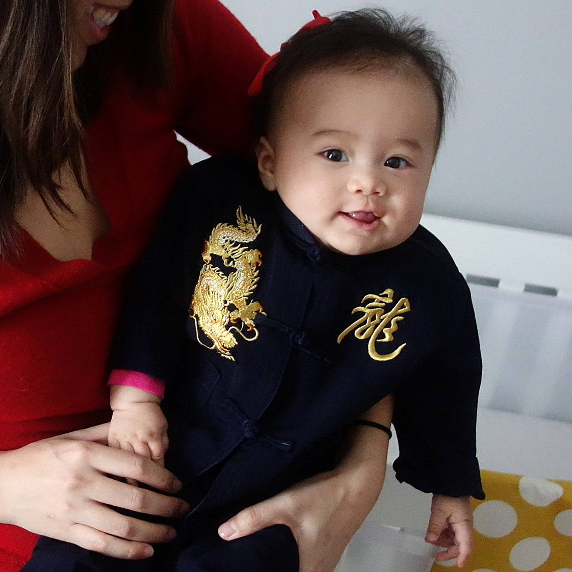 "The journalist with her half-Chinese daughter, Eva, on the Lunar New Year. Eva's outfit says ""dragon"" in Chinese."