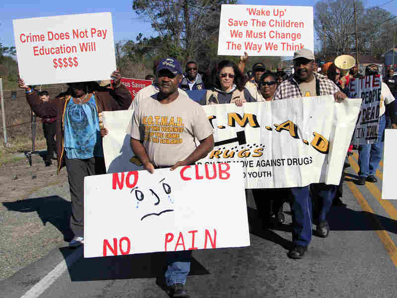 Led by the Rev. Willie Phillips (center), protesters march in February against violence in and around Club Majestic.