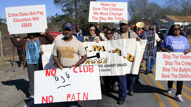 Led by the Rev. Willie Phillips (center), protesters march in February against violence in and around Club Majestic. (Courtesy of The Ledger Enquirer)